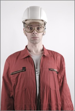 Man wearing coverall + safety glasses + helmet